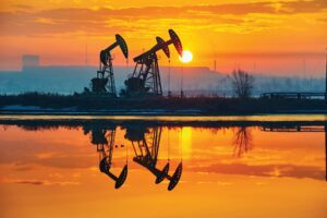 The sunrise of oil field landscape